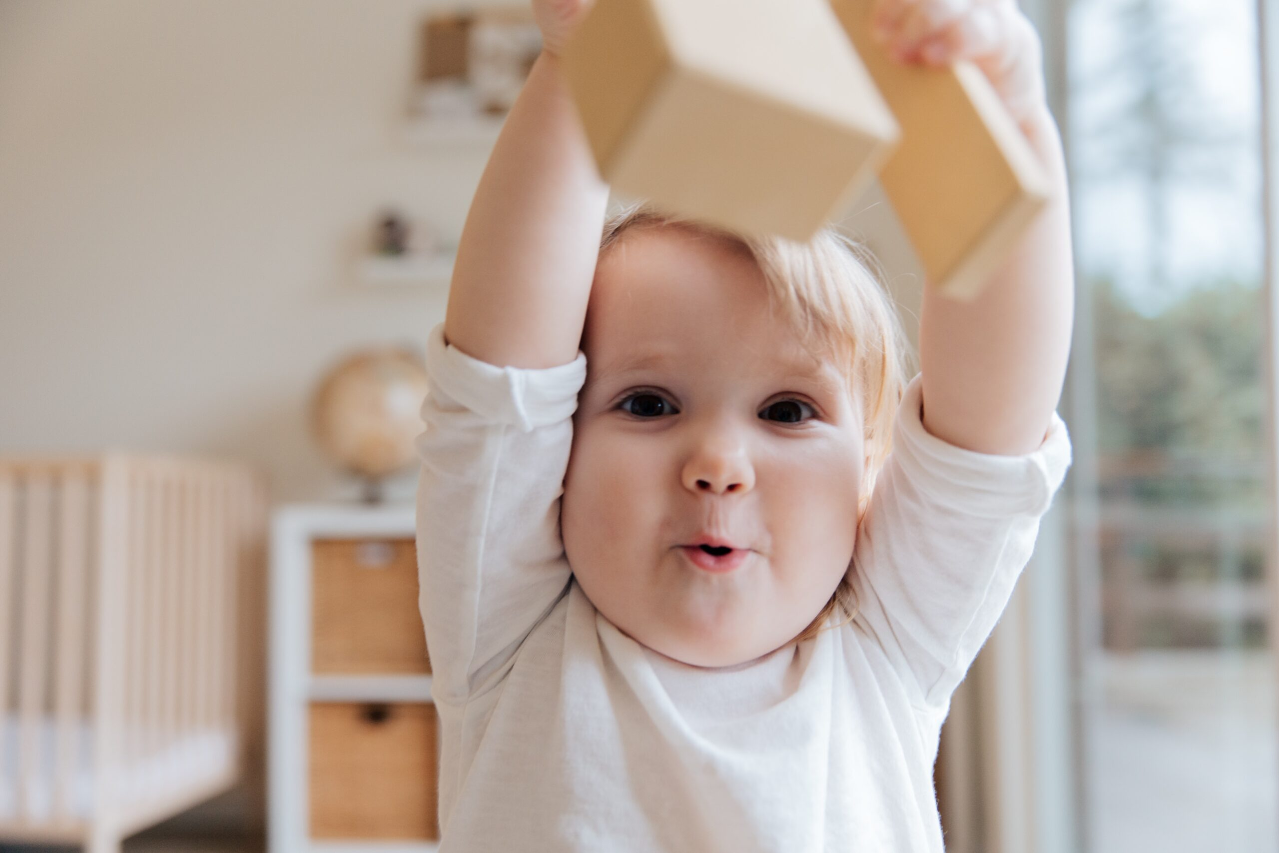 young child playing with wooden building blocks